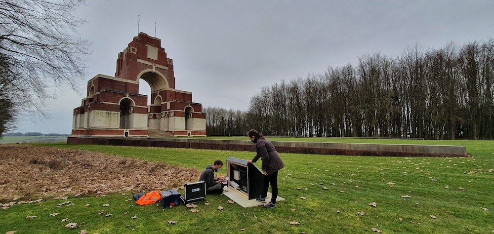Thiepval memorial in background. Solar powered Info Point plinths in foreground