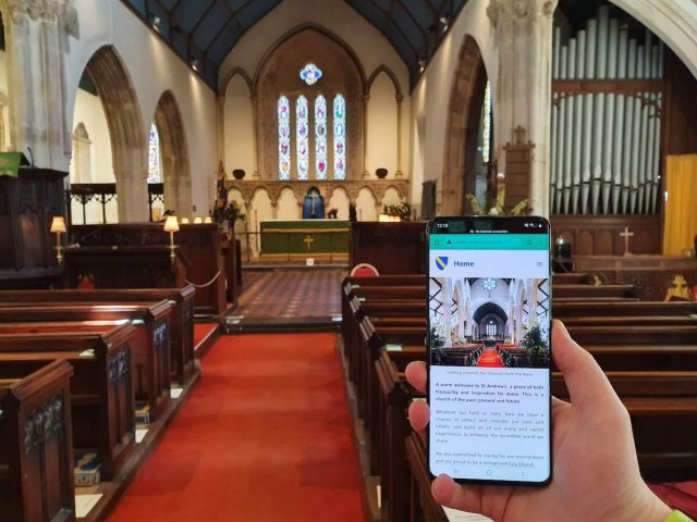hurch tour displayed on a phone connected to Info Point inside the church