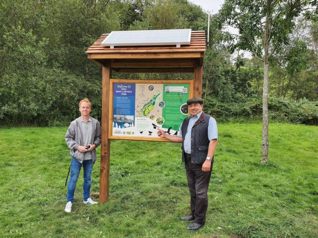 Members of the Bedlinog community pose with the Info Point digital sign